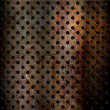 Foto Stock: Rusty perforated metal background