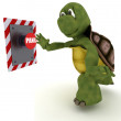 Tortoise pushing a button — Stockfoto