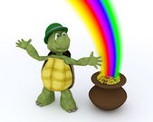 Tortoise with pot of gold and rainbow — Stock Photo