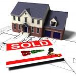 House on blueprints — Stock Photo