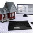 Classic Timber House with computer and blueprints — Stock Photo #37377821