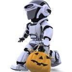 Robot with jack o lantern pumpkin — Stock Photo #37378563