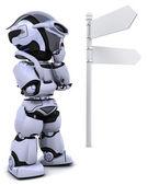 Robot at a signpost — Stock Photo