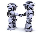Robots shaking hands — Stock Photo