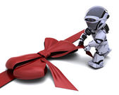 Robot with gift bow — Stock Photo