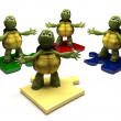 Stock Photo: Tortoises on jigsaw pieces