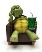želva relexing v křesle pít sodovku — Stock fotografie