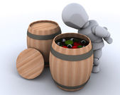 Man bobbing for apples in a barrel — Stock Photo