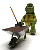 Tortoise gardener with a wheel barrow carrying soil — Stock Photo
