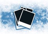 Polaroids on snowflake background — Stock Photo