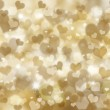 Glittery gold hearts background — Stock Photo