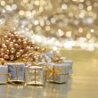 Christmas gifts and golden decorations — Stock Photo #39370525