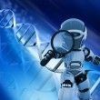 Robot with magnifying glass on DNA background — Stock Photo #39370717