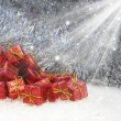 Christmas gifts in snow — Stock Photo