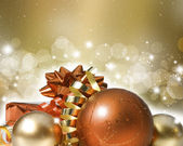 Christmas ornaments on decorative background — Stock Photo