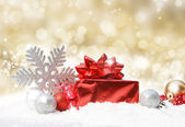 Christmas decorations on gold glittery background — Stock Photo