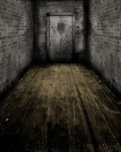 Grunge Interior with a prison door — Stock Photo