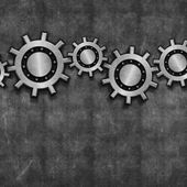 Interlocking gears on grunge — Stock Photo