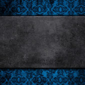 Grunge concrete on a floral background — Stock Photo