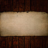 Old paper on grunge wood — Stock Photo
