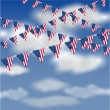 American flag bunting in the sky — Stock Vector
