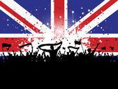 Football crowd with banners and flags on union jack — ストックベクタ