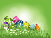 Easter eggs in grass — Vector de stock