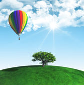 3D landscape with tree and hot air balloon — Stock Photo