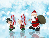 Christmas background with Santa and his helpers — Stock Photo