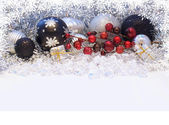 Christmas decorations with snowflake border — Stock Photo