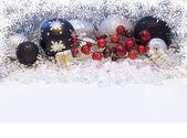 Christmas decorations with snowflake border — Stock Photo