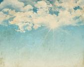Grunge background of a sunny blue sky — Stock Photo