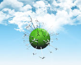 Wind turbines on a grassy globe — Stock Photo