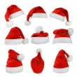 Set of red Santa Claus hats isolated on white background  — Photo