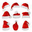 Set of red Santa Claus hats isolated on white background — Stock fotografie