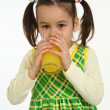 Portrait little girl drinking orange juice — Stock Photo
