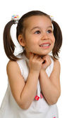 Little girl on a white background looks away — Stock Photo