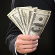 Businessman holding money in his hand — Stock Photo