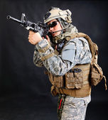 Soldier with rifle on a white background — Stock Photo