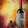 Foto Stock: Composition of wine and grape, on brown background