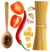 Pasta, spaghetti, vegetables and spices, on a wooden table, on a — Stock Photo