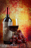 Composition of wine bottle, glass and grape, on brown background — Stock Photo