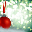 Christmas background with red bauble — Stock Photo #31840633