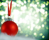 Christmas background with red bauble — Stock Photo