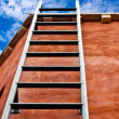 Royalty-Free Stock Photo: Ladder leading up to the blue sky