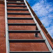 Ladder leading up to the blue sky — Stock Photo