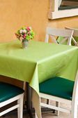 White and green chair with table — Stock Photo