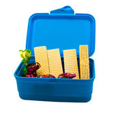 Plastic container with faflâmi and sweets. — Stock Photo