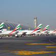 Emirates Aircraft at Dubai Airport - Stock Photo