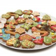 Plate full of various small christmas cookies — Stock Photo #26955539
